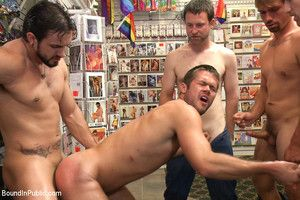 Mike de Marko is bound and beaten by the horny public.