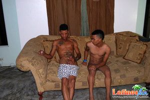 Team of two of bored Latino twinks giving head for fun