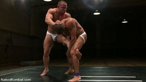 Two muscle gods fight naked be incumbent on sexual domination in the end.
