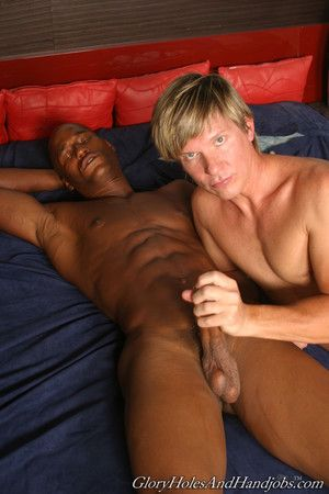 Cute man playing with huge black cock in gay interracial action