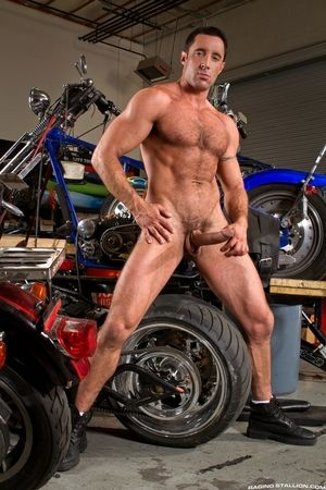 In the Auto Despondent Motorcycle Shop, Nick Capra chews the stubble on David Benjamins chin. David leans in to give Nicks hairy chest and armpits a tongue bath and tease Nicks nipples. They lock lips, swap spit, and grapple, maximizing contact between fl