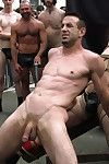 Muscle slave is stripped naked, used and humiliated while Archery nock of people take photos.