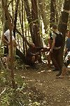 Campers gang bang a ripped shine tied beside a tree in the woods.