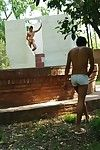Well-built hunk luring a boy into outdoor oral sex