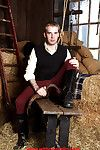 Gay stud masturbating his hard cock median an empty barn