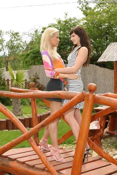 Hot lesos kiss uterus in outdoor sixtyniner