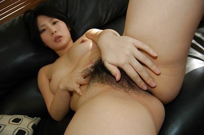 Oriental infant model charming off her underclothing and teasing her wavy gash in close up