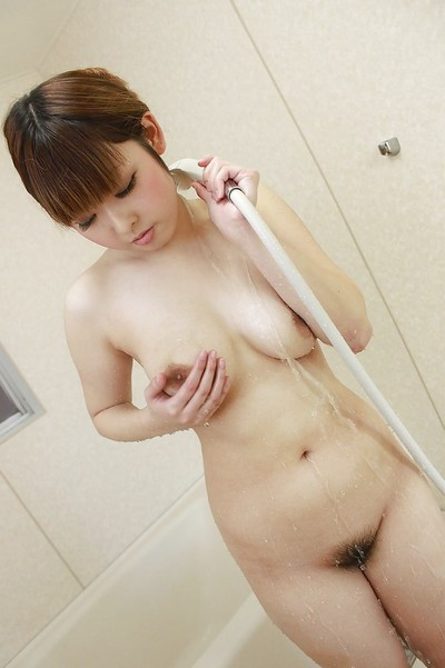 Curvy Chinese infant Honoka Ono jolly baths and exposing her trimmed fur pie