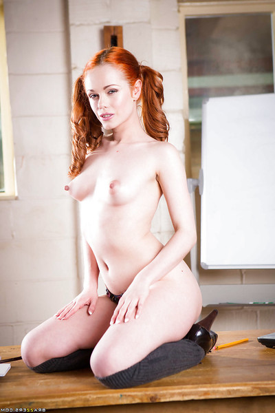 Redhead schoolgirl Ella Hughes posing in pigtails while revealing small pointer sisters