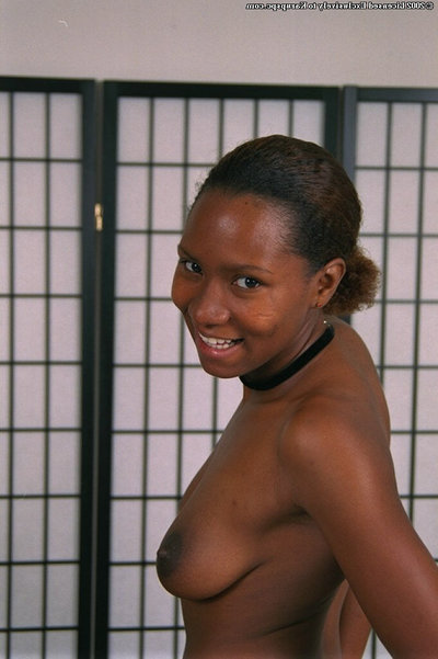 Youthful African babe Dazy plays with her all-natural boobies