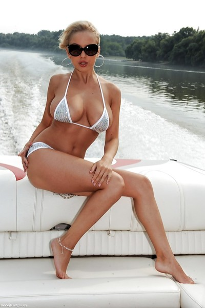 Infant and breasty Euro queen Mandy I shedding bikini outdoors on boat
