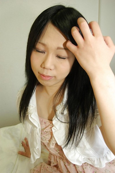 Shy asian young getting undressed and showing off her bushy gash in close up