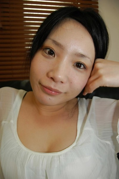 Shy oriental amateur undressing and teasing her love-cage lower her underwear