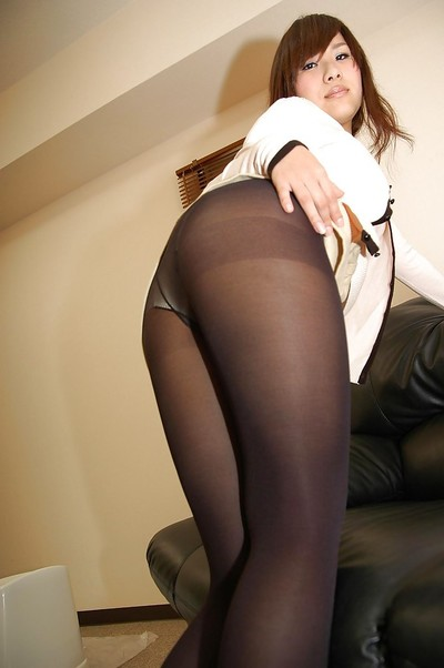 Chinese juvenile in pantyhose undressing and exposing her gash in close up