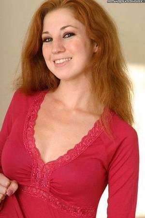 Ample-breasted redhead young undressing and exposing her shaved cage of love