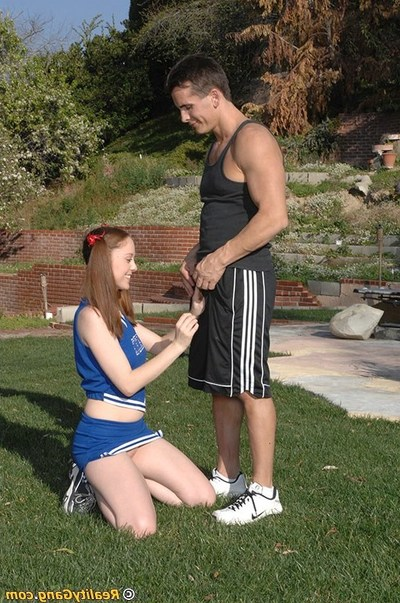 Salacious cheerleader Scarlett Fay receives fucked in group and facialized outdoor
