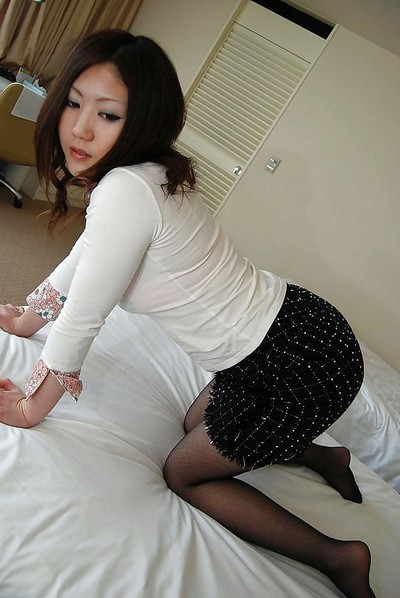 Chinese juvenile in pantyhose undressing and exposing her wavy gash in close up