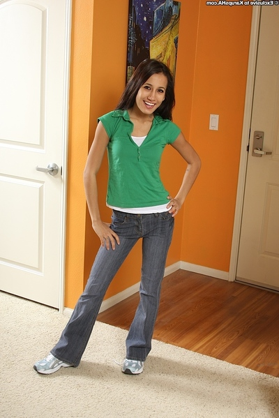 Elegant juvenile Amia with petite front bumpers undressing her jeans sluggishly