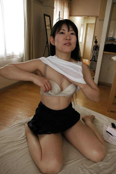Japanese Milf doll Ayane Ikeuchi posing in schoolgirl uniform and cylinder