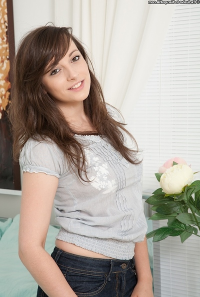 Energetic infant beauty with trimmed pubis undressing and stretching her legs