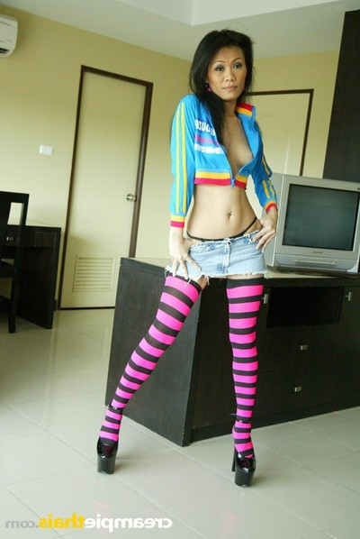 Pla undresses her pink and ebon striped nylons