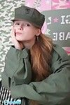 Appealing adolescent year old juvenile in military uniform