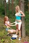 Blond and redhead bawdy lesbo nubiles playing outdoors