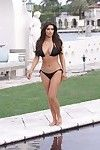 Adolescent celeb kim kardashian posing on the beach