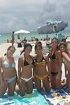 Undressed young girls take part in both at a public beach