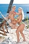 Jennifer and nesty push compress up their apple bottoms on the beach