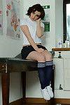 Short haired splendid Victoria Porter modeling in skirt and knee socks