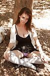 Cute brunette young Essie Halladay posing and flashing outside