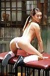 Adolescent Japanese pornstar Alina Li posing seductively in schoolgirl uniform