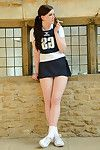 Eighteen year old schoolgirl Jessica-Ann Fegan having smoke in cheerleader outfit
