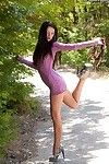 Slim brown hair amateur undressing and posing bare outdoor