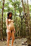 Beautiful Japanese adolescent darling with remarkable jugs posing in nature\'s garb outdoor