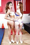 Girl-on-girl cheerleaders August Ames and Emma Stoned showing their butts