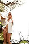Seductive blond coed Brandi Lynn posing solely sheltered outdoor
