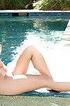 Smokin\' hot eastern gal with vast jugs stripping by the pool
