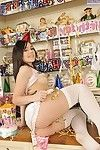 Pitiless young in white stockings erotic dancing and demonstrating her goods