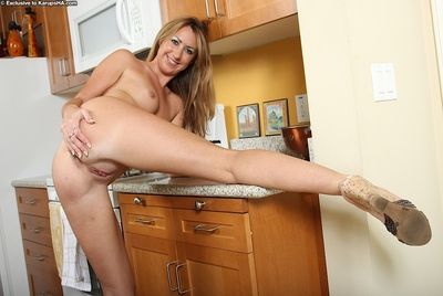 Nasty looking blonde whore Lacey undressing to show her ass and pussy