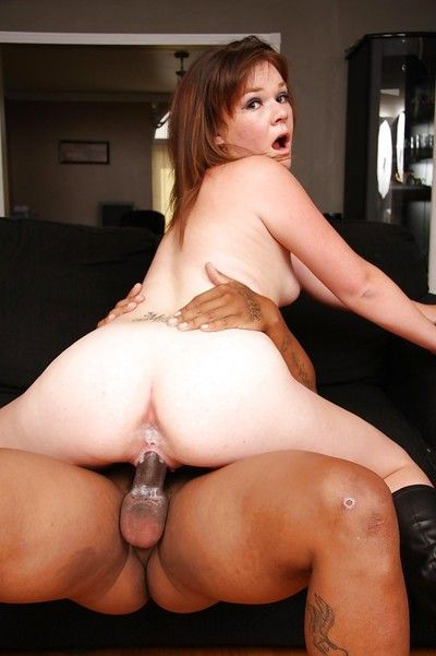 Lecherous slut Cassie Holiday blows and fucks a rigid black boner