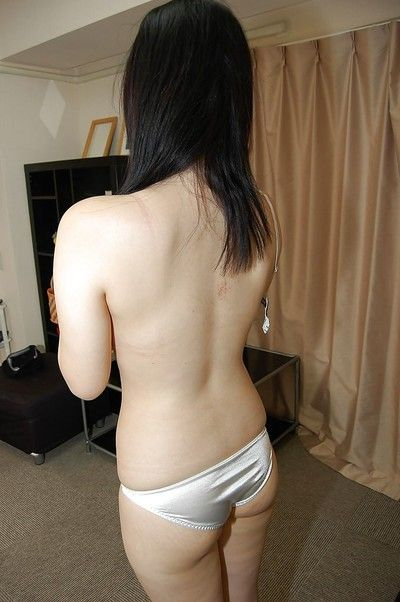 Cute asian pet Chiharu Moriya getting naked and rubbing her clit