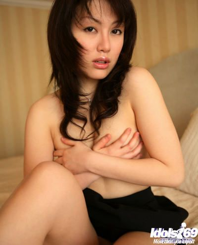 Horny asian cutie stripping and toying her muted pussy superior to before the bed