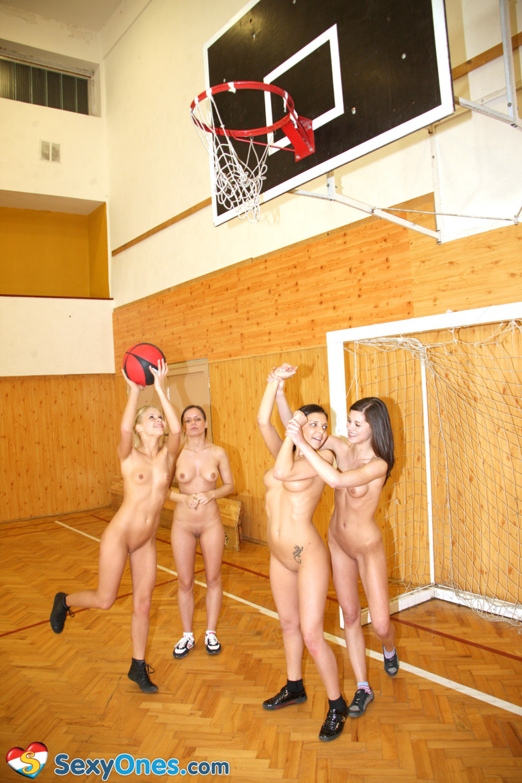 Schoolgirls playing basketball as mother gave birth