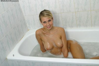 Amateur blonde Renata wets her big bosom wide shower and poses in one\'s birthday suit