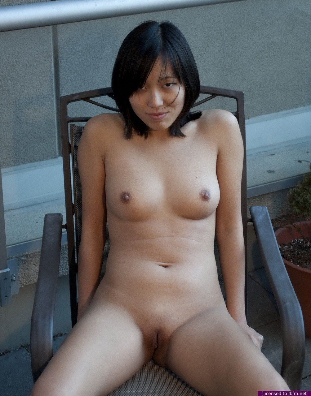 Juvenile Japanese is showing off her attractive body outdoors