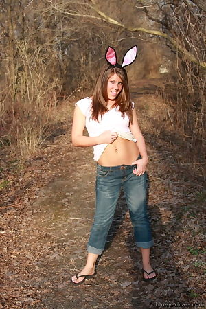 Youthful girl Cass dresses up get pleasure bunny and undresses in the woods.