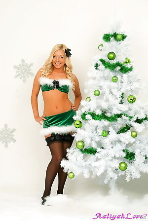 Christmas gallery with a beautiful fairy-haired adolescent celebrating her stripped body