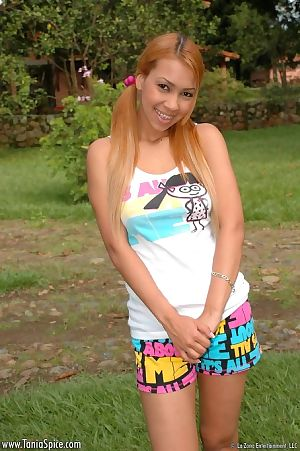 Pig-tailed young latin chick with dyed hair shows u her paradisiacal body